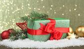 Beautiful bright gift and christmas decor, on shiny background — Stock Photo