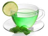 Taza transparente de té verde con salvia y cal aislado en blanco — Foto de Stock
