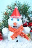 Beautiful snowman on snow — Stock Photo