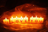 Candles with printed sign I LOVE YOU,on dark background — Stock Photo