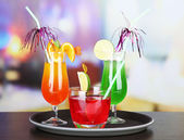 Set of different drinks on tray, on bright background — Stok fotoğraf