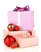 Gifts with christmas balls, isolated on white — Stock Photo