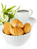 Tasty croissants and cup of coffee isolated on white — Stock Photo