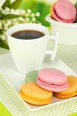 Coffee and macaroons on table close-up — Stock Photo