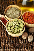 Many different spices and fragrant herbs on braided table close-up — Stock Photo