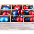 Christmas toys in wooden box isolated on white — Stock Photo #32561185