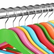 Colorful clothes hangers on gray background — Stock Photo #32562199