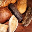 Much bread on wooden board — Stock Photo #32562275