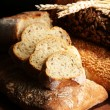 Much bread on wooden board — Stock Photo #32562291