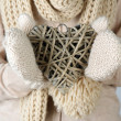 Female hands with wicker heart, close-up — Stock Photo #32563459