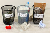 Three buckets of assorted debris on room background — Stock Photo