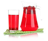 Pitcher and glass of compote on napkin isolated on white — Stock Photo