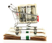 Shopping trolley with dollars, isolated on white — Zdjęcie stockowe