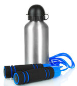 Sports bottle and skipping rope isolated on white — Stock Photo