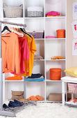 Women wardrobe in sunny colors — Stock Photo