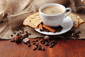 Cup of tasty coffee with tasty Italian biscuits, on wooden background — Stock Photo