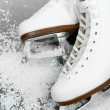 Figure skates in snow close-up — Stock Photo #32681947