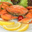 Stock Photo: Boiled crab on white plate with salad leaves and tomatoes, close-up