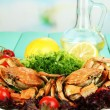 Stock Photo: Boiled crabs on white plate with salad leaves and tomatoes,on wooden table, on bright background