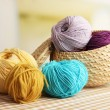 Multicolored clews in wicker basket closeup — Stock Photo #32682799