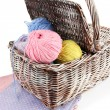 Multicolored clews in wicker basket with napkins closeup — Stock Photo #32682823