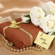Romantic parcel on gold cloth background — Stock Photo #32683215