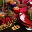 Table setting for Halloween with pumpkin and candles close-up — Stock Photo #32683863
