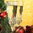 Composition with Christmas decorations and two champagne glasses, on bright background — Stock Photo #32684555