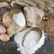 Stock Photo: Wholemeal flour in scoops on wooden table