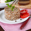 Buckwheat in plate with bread and vegetables closeup — Stock Photo #32685489