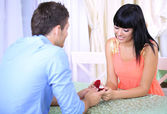 Man proposing engagement ring his woman in restaurant — Stock Photo