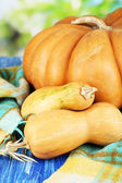 Ripe pumpkins on fabric on natural background — Stock Photo