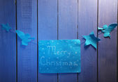 Signboard with words Merry Christmas on wooden table background close-up — Stock Photo