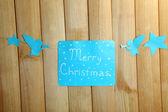 Cartello con le parole sul primo piano di tavolo in legno sfondo buon natale — Foto Stock