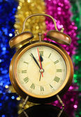 Golden clock on bright background — Stock Photo