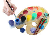 Paint brushes and multicolored paints isolated on white — Stock Photo