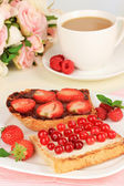 Delicious toast with berries on table close-up — Stock Photo