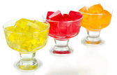 Tasty jelly cubes in bowls isolated on white — Stock Photo