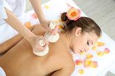 Beautiful young woman having back massage close up — Stock Photo