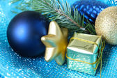 Beautiful Christmas decor on blue cloth — Stock Photo