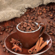 Stock Photo: Coffee beans in cup on wooden background