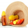 Bottles with suntan cream in hat isolated on white — Stock Photo