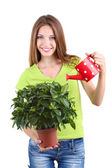 Beautiful girl with flower in pot isolated on white — Stockfoto