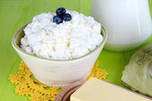 Fresh cottage cheese with blueberry on wooden table close-up — Stock Photo