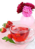 Delicious strawberry tea on table on white background — Stock Photo
