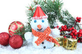 Beautiful snowman on snow, isolated on white — Stock Photo