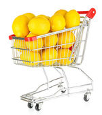 Ripe lemons in trolley isolated on white — Stock Photo