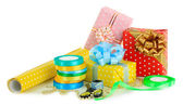 Materials and accessories for wrapping gifts isolated on white — Stock Photo