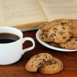 Cup of coffee with cookies and books on wooden background — Stock Photo