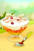 Tasty jelly in bowl on table on light background — Stock Photo